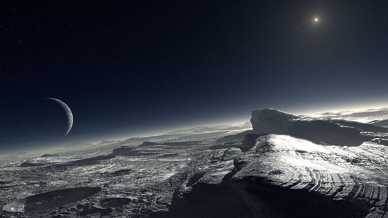 800px-ESO-L__Cal%C3%A7ada_-_Pluto_%28by%29.jpg